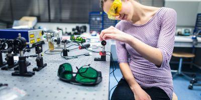 researcher in quantum optics lab