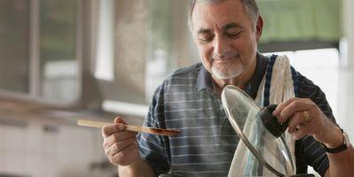 Image of older man cooking