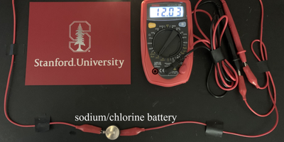 An LED light powered by a prototype rechargeable battery using the sodium-chlorine chemistry developed recently by researchers at Stanford University.